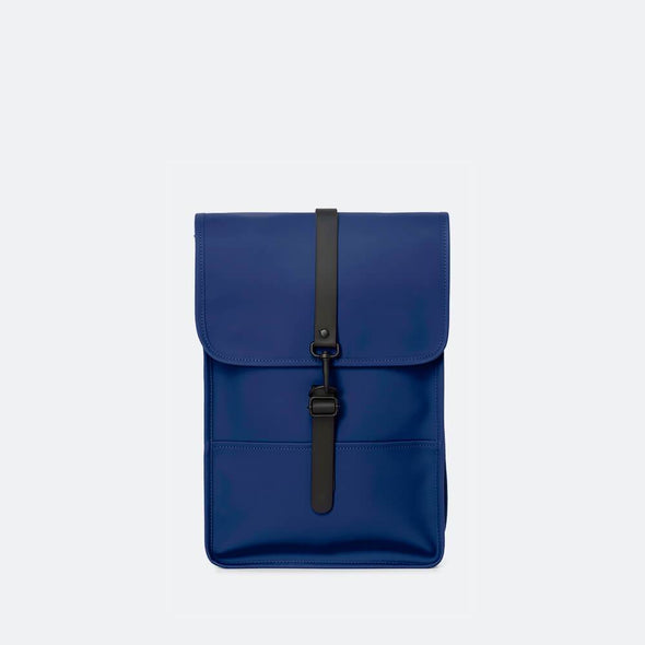 Minimalist mini backpack with a boxy design in klein blue waterproof synthetic material.