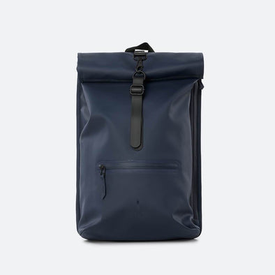 Navy blue minimalist waterproof backpack with a roll-top closure and an adjustable strap.