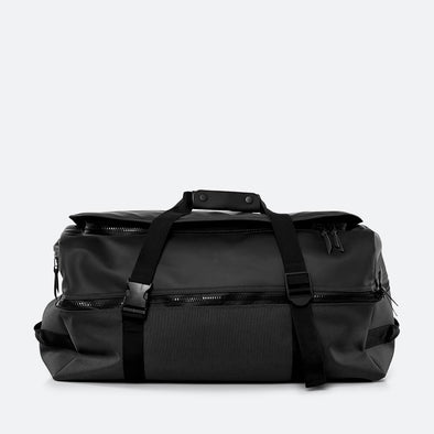 Black multifunctional bag to be worn as both a backpack and a carry all bag.