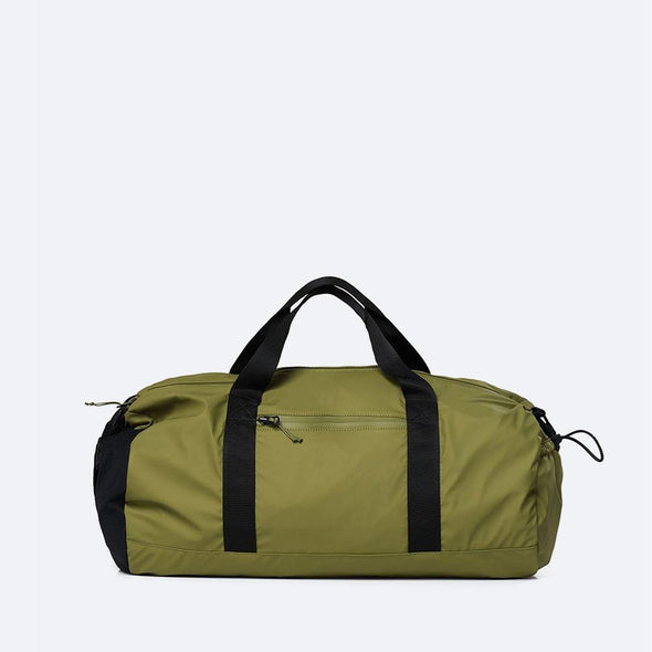 Minimalist duffle bag in sage green waterproof synthetic material.