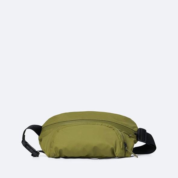 Minimalist hip bag in sage green waterproof synthetic material.