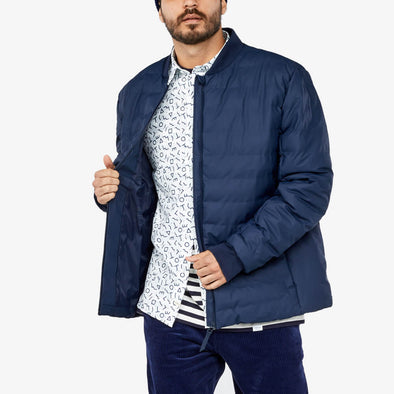 Blue modern and functional rainwear item with a casual fit.