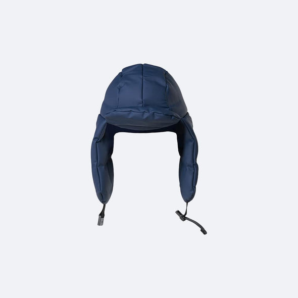 Minimalist navy blue puffer hat in waterproof synthetic material.