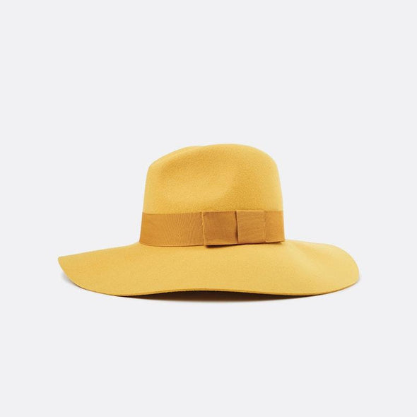 Yellow wide-brim floppy felt hat with a grosgrain band.