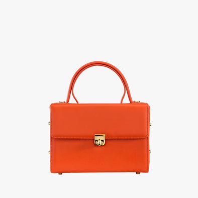 Boxy bag n orange leather with golden metallic clasp with handle and detachable shoulder strapi