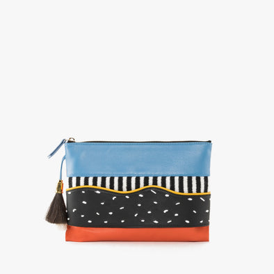 Thin leather multi-colored pouch in orange and turquoise blue with textile appliques in blck and white with top zipper and tassel