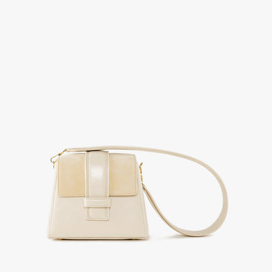 Mini bag with geometrical shape in off-white leather with suede flap and golden clasp and thick detachable leather strap