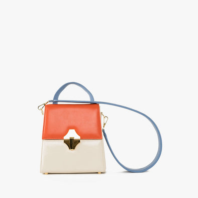 bag with geometrical shape in a combination of off-white, orange and blue leather with golden clasp and thick detachable blue leather strap
