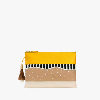 Thin leather multi-colored pouch in orange and turquoise blue with textile appliques in black and white with top zipper and tassel