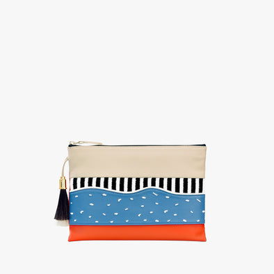 Thin leather multi-colored pouch in beige and orange leather with textile appliques in blue black and white with top zipper and tassel