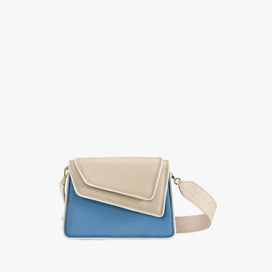 Shoulder bag in a color block combination of blue and off-white leather with asymmetrical flap and thick detachable off-white leather strap with embroidered details