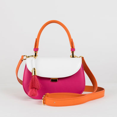 Structured micro bag in fuchsia pink leather with white flap, handle and detachable shoulder strap