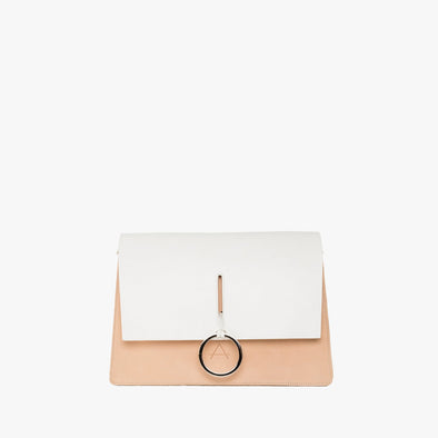 Geometrical shoulder bag with natural chemical-free leather and white flap and strap, with silver ringlet that also acts as a closure mechanism