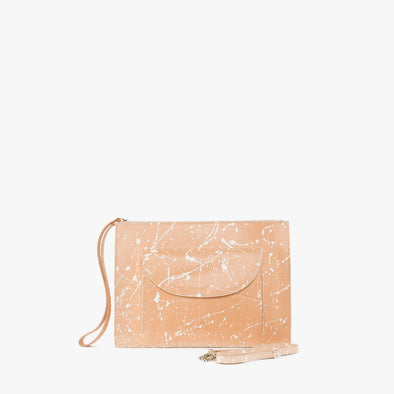 Minimalist rectangular clutch in natural chemical-free leather with white handpainted splatters, zipper with leather wrist handle and detachable thin strap