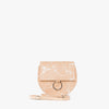 Round minimalist shoulder bag in natural color leather handpainted in a splatter-style in white with silver hoop embellishment on the flap and detachable strap