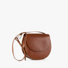 Rounded minimalist shoulder bag in camel chemical-free leather