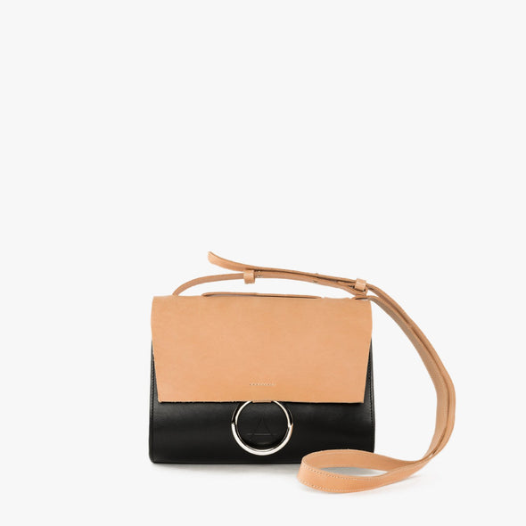 Geometrical shoulder bag with rounded angles in natural chemical-free leather with white flap and strap and decorative silver hoop