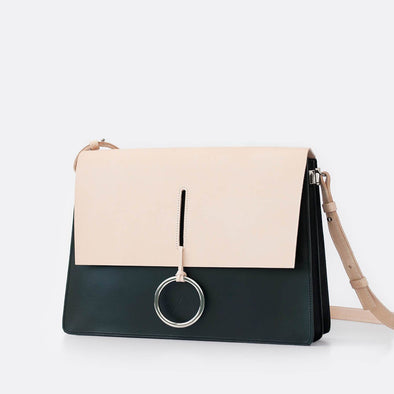 Minimalist shoulder bag in black and natural.