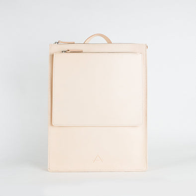 Minimalist slim backpack in chemical-free leather with adjustable straps.