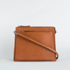 Women's minimalist geometrical shoulder bag in chemical-free leather.