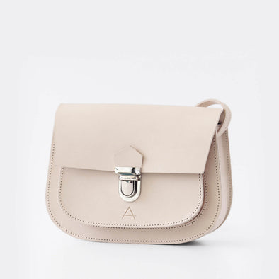 Minimalist saddle bag in natural chemical-free leather.