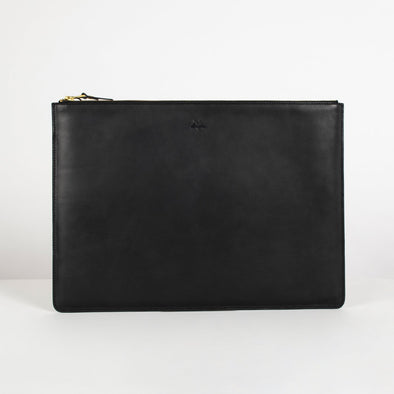Leather padded clutch fit for Macbook with golden hardware. Features an embossed brand logo at front., zipper fastening and full lining.