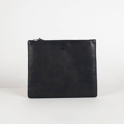 Leather clutch fit for Ipad with silver hardware. Features an embossed brand logo at the front, zipper fastening and full lining.