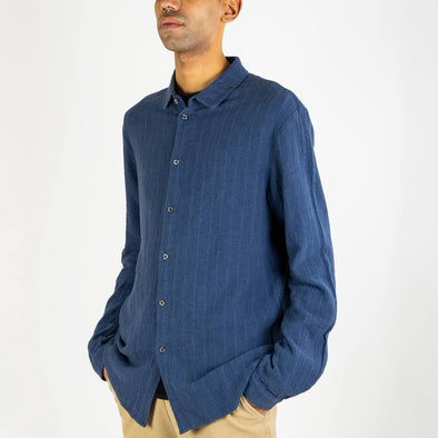 Navy blue shirt with long sleeves and regular fit.