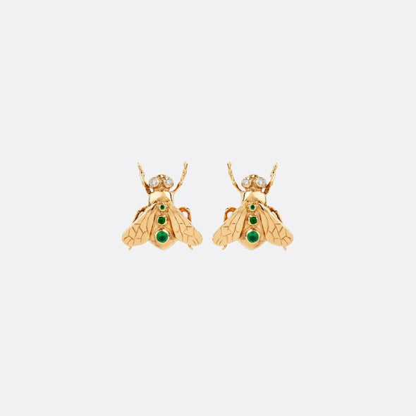 Golden earrings with bee shape featuring zircons and micropearls.