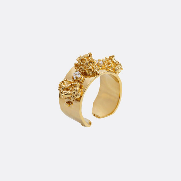 Golden campanulas ring with zircons.