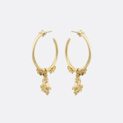 Golden dead flowers hoop earrings with zircons.