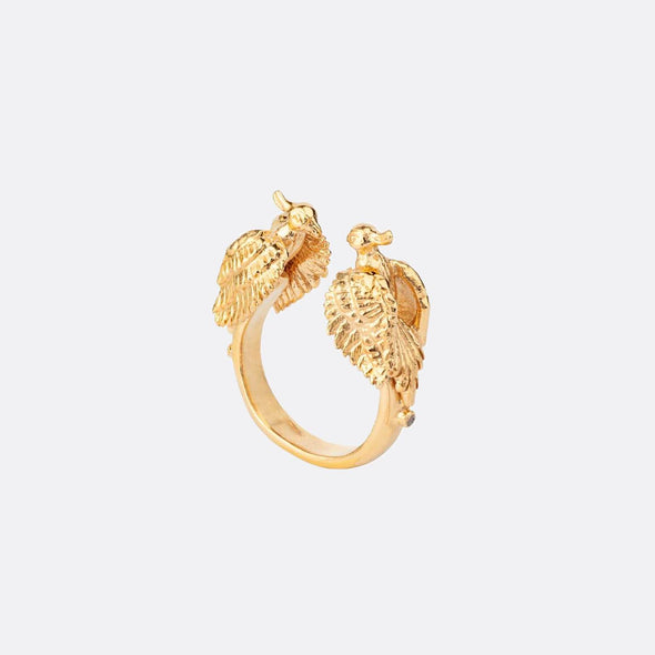 Golden open ring featuring two birds.