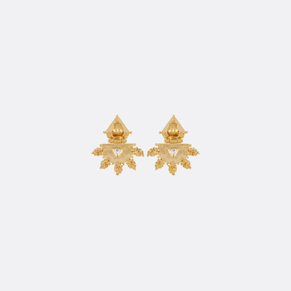 Golden geometric earrings with zircons.