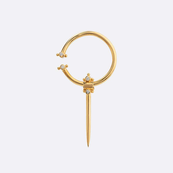 Medium gold plated earring with fibula and inset zircons.