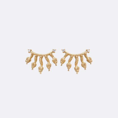 Small gold plated earrings with snake motifs and inset zircons.