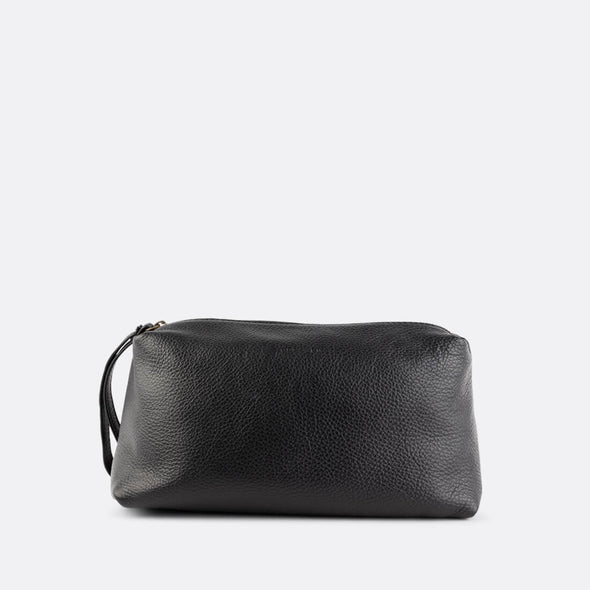 Black wash bag made from supple Italian full-grain leather.