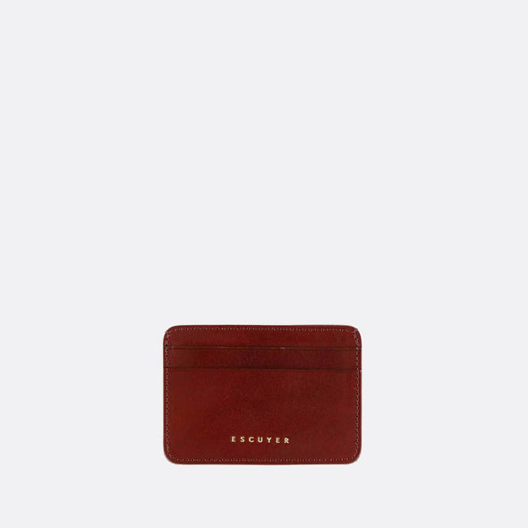 Sophisticated burgundy leather cardholder for cards and folded notes.