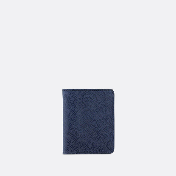 Sophisticated blue leather slim wallet with 6 card slots and a bill sleeve.