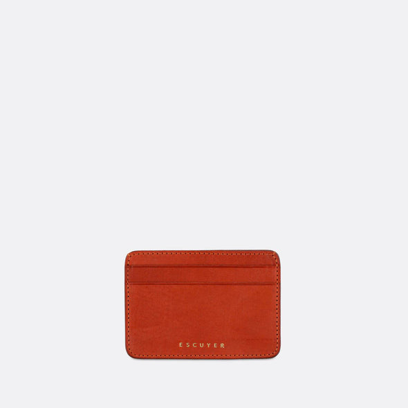 Sophisticated orange leather cardholder for cards and folded notes.