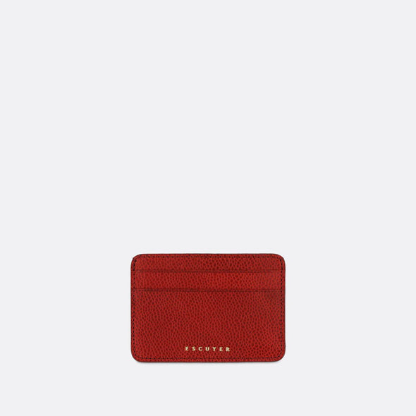 Sophisticated red leather cardholder for cards and folded notes.