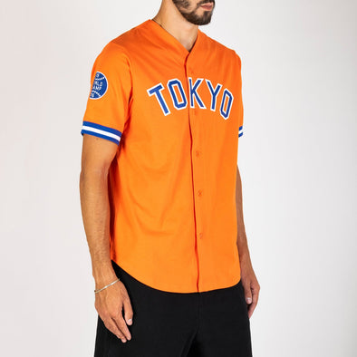 "Champion x Beams orange baseball t-shirt with ""Tokyo"" print across the chest."