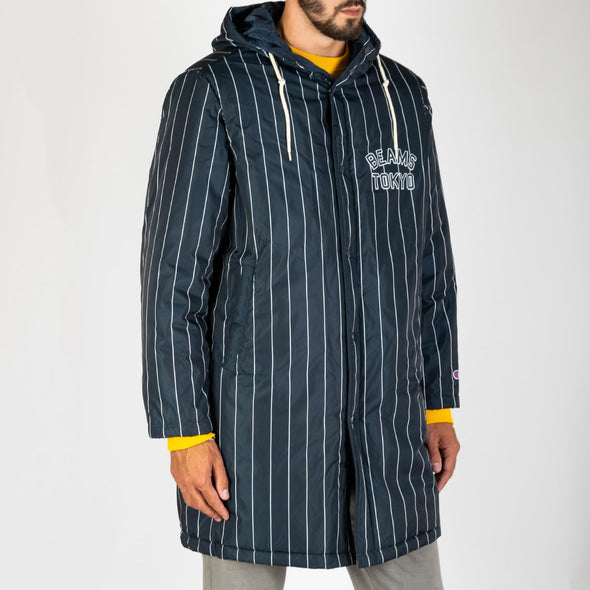 Champion x Beams thermal padded baseball coat made from a dark navy padded durable polyester with white stripes.