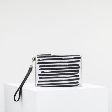 Black cow leather clutch with shoulder strap and golden details.