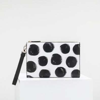 Limited edition cow leather clutch with shoulder strap and golden details.