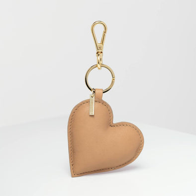 Beige key ring with heart shape.
