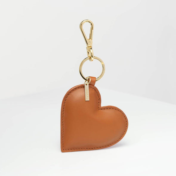 Brown key ring with heart shape.