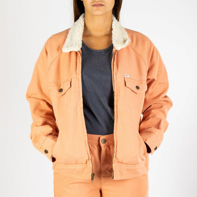 Dusty coral canvas zip-up jacket insulated for warmth with quilted sleeves.