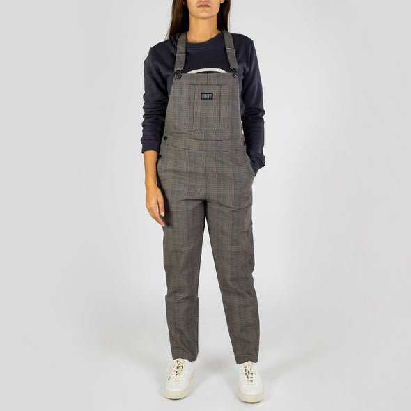 Feminine plaid fit overalls with straight leg, custom logo hardware and patch.