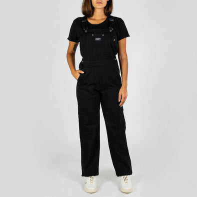 Feminine black fit overalls with straight leg, custom logo hardware and patch.
