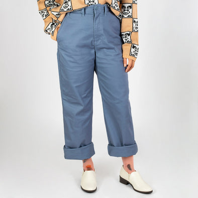 Dull blue high-waisted wide leg trousers cut throughout the hips.